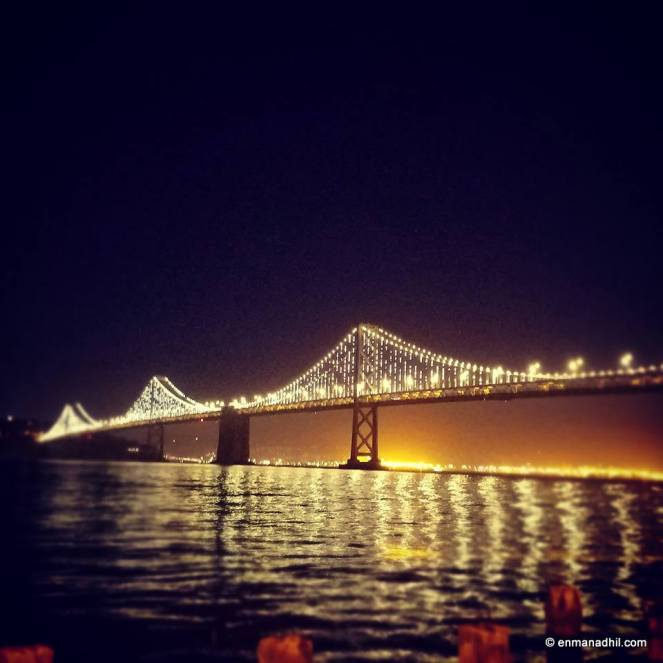 Bay Bridge San Francisco CA lit up in the evening water front